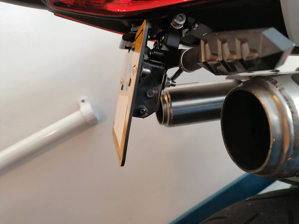 Motorcycle license plate flippers